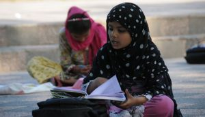 Underprevileged Pakistani children study in an open space at...