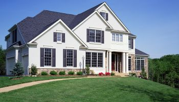 House exterior with surrounding yard