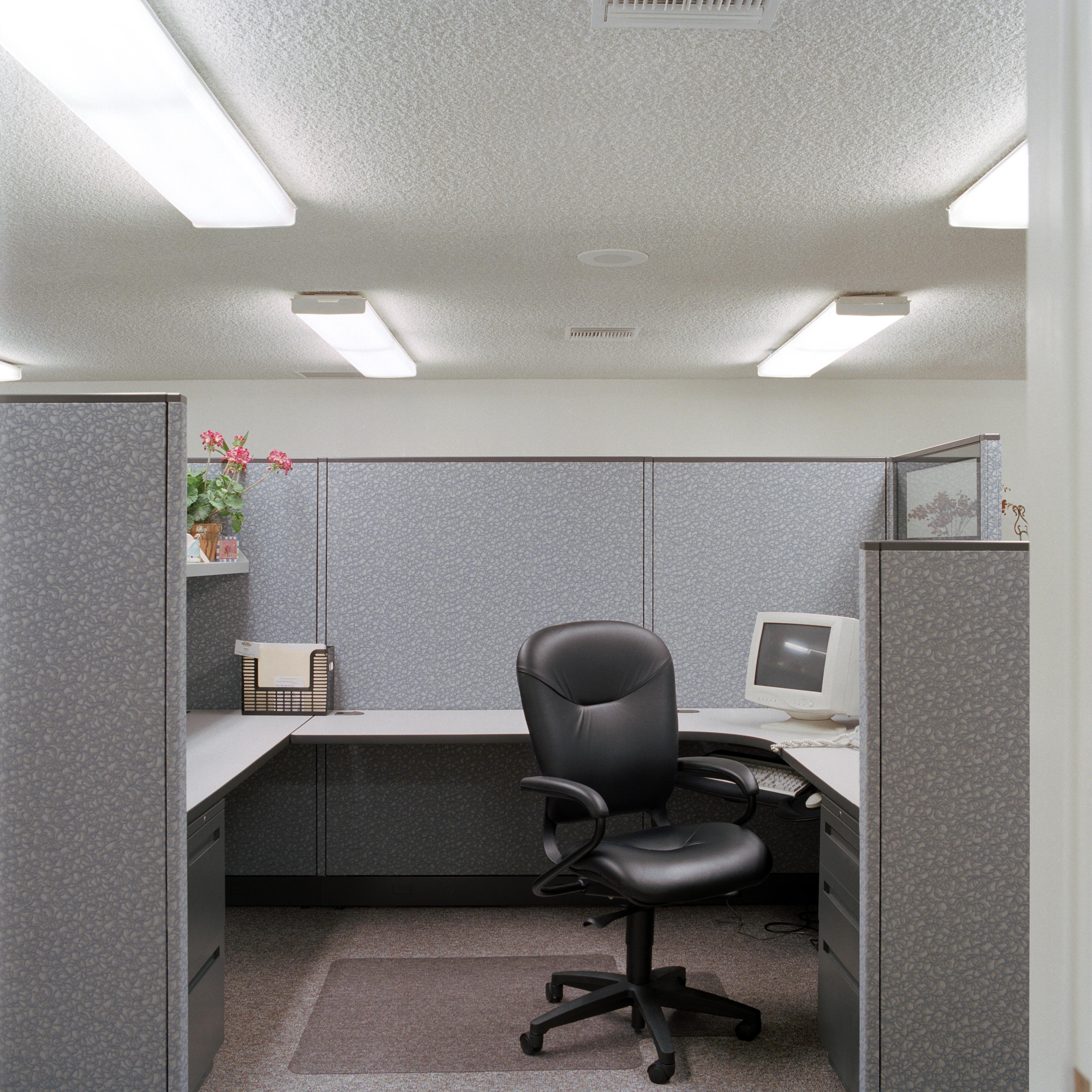 Computer and chair in cubicle