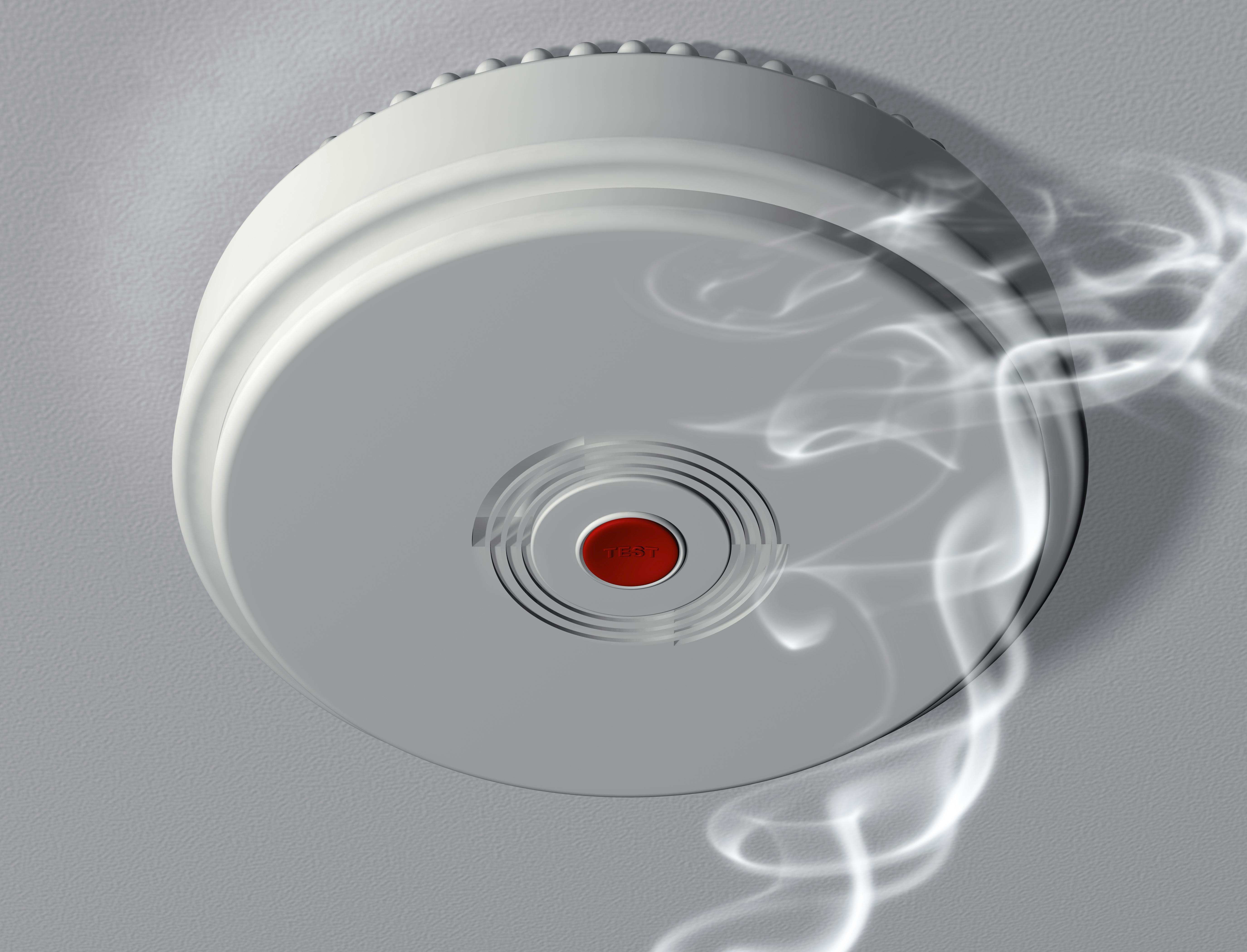 Illustration of a smoke alarm warning of a fire