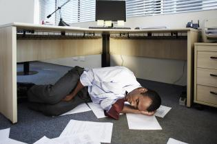 Mid Adult Man Sleeping Near Documents on Floor
