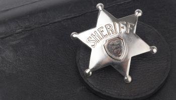 Sheriff's badge on dark background