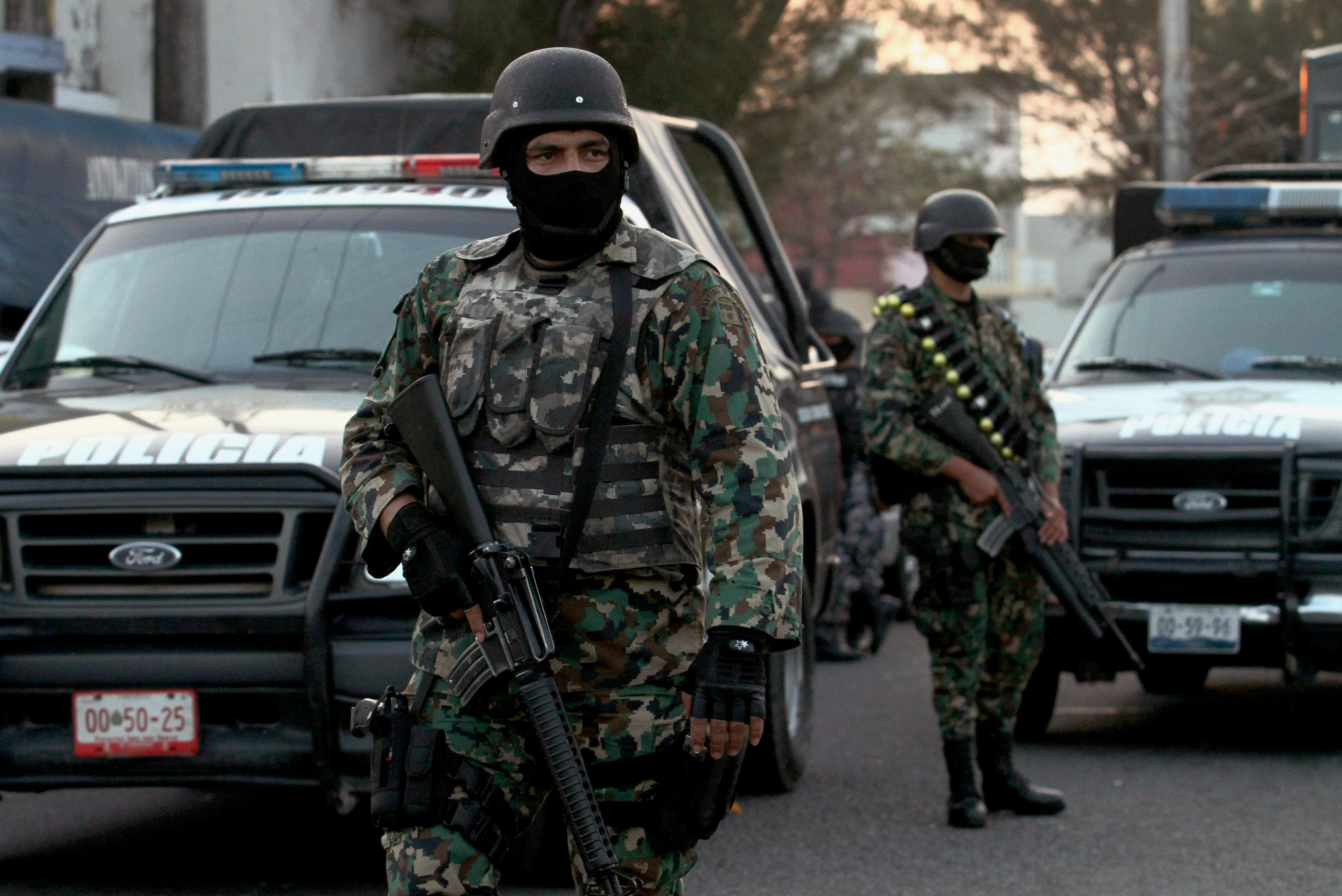 Mexican marines stand guard in front of