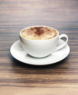 Coffee cup on wooden surface