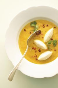 Coconut pumpkin soup with semolina dumplings, close-up