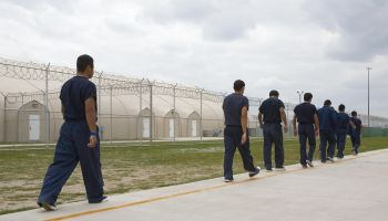 Detainees walk the line inside Homeland...
