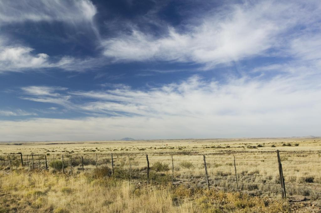 USA, Texas, Marfa, fence across ranch land
