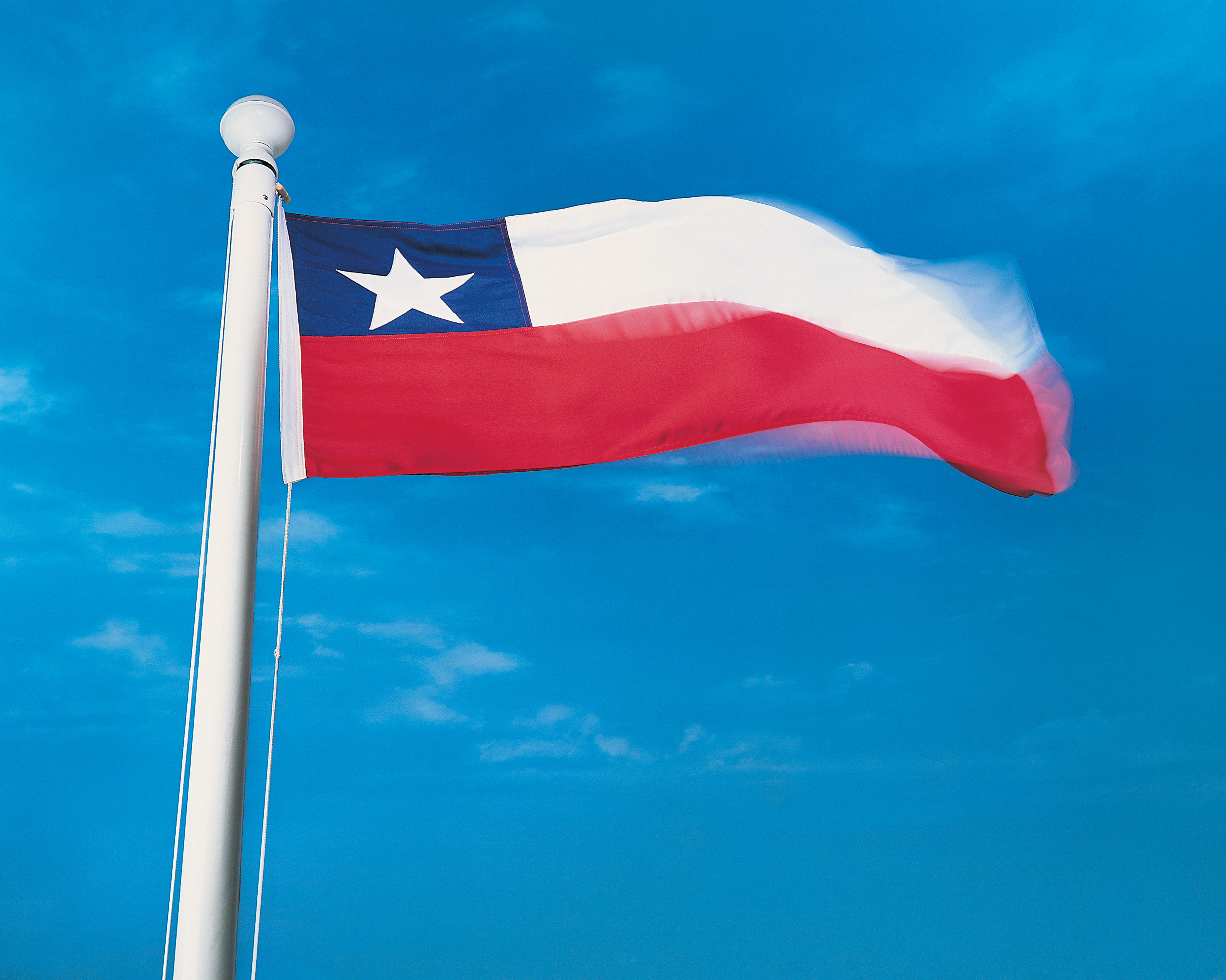 Flag of Chile on flagpole waving in the wind
