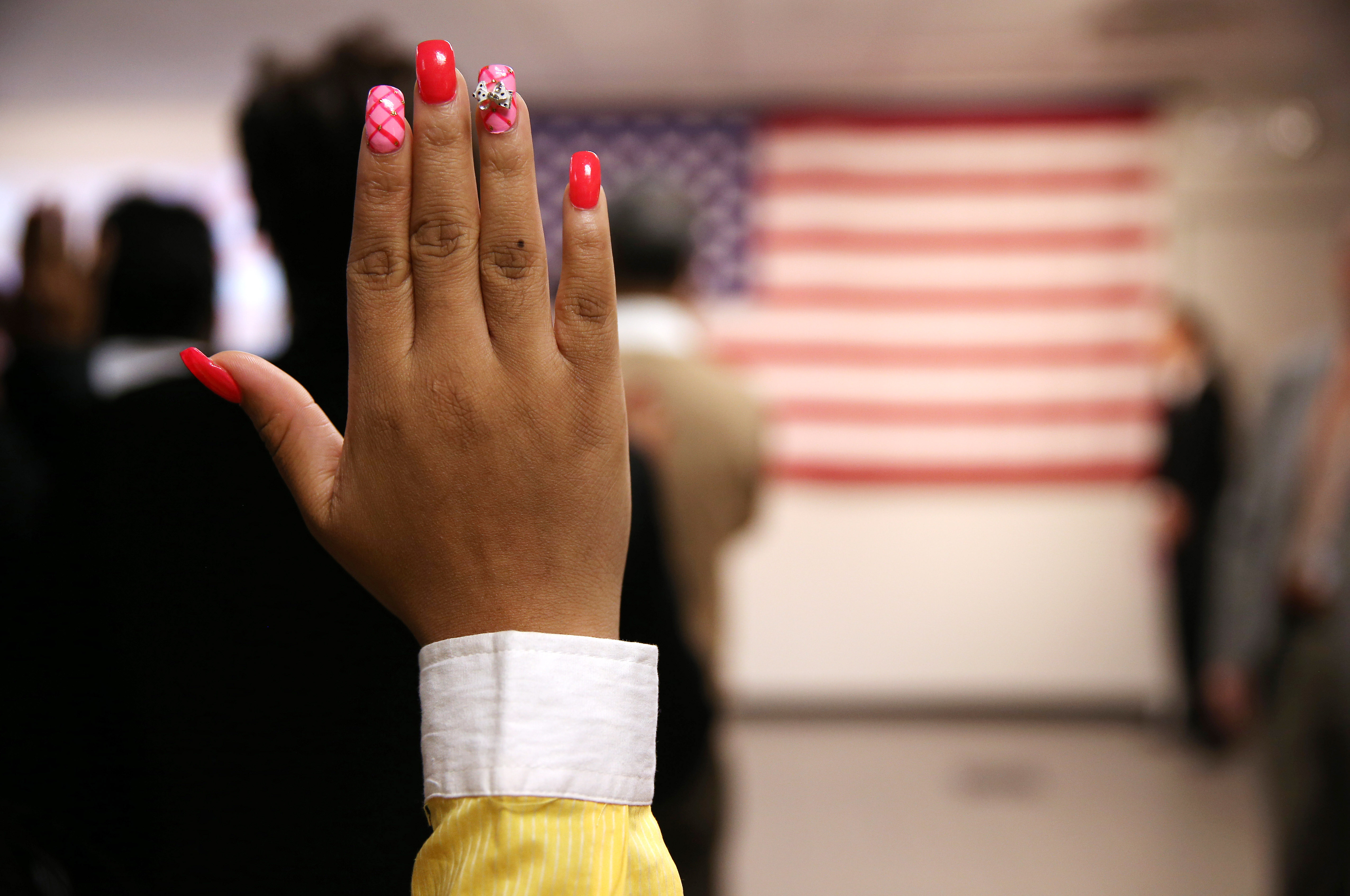 Immigrants Sworn In As US Citizens At Naturalization Ceremony