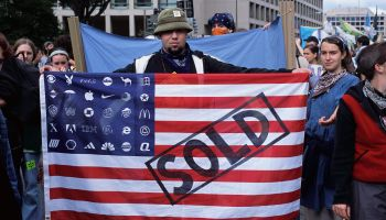 Protester Displays a Modified American Flag