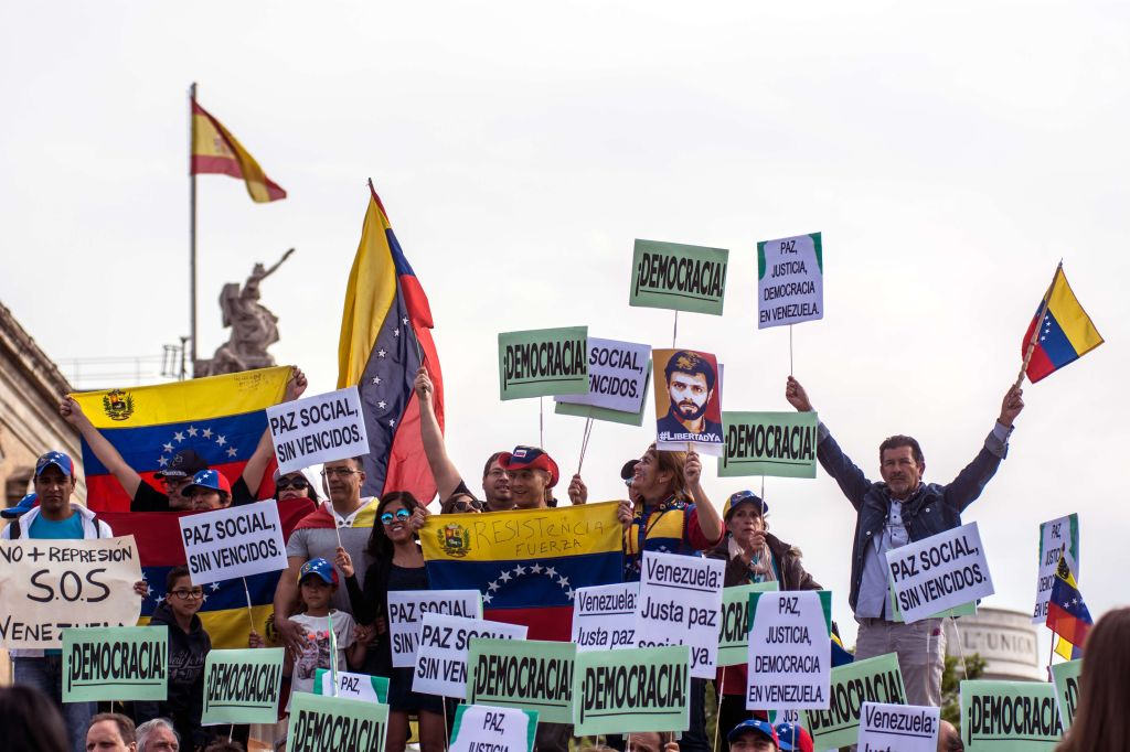 Venezuelans protesting the current situation of their...