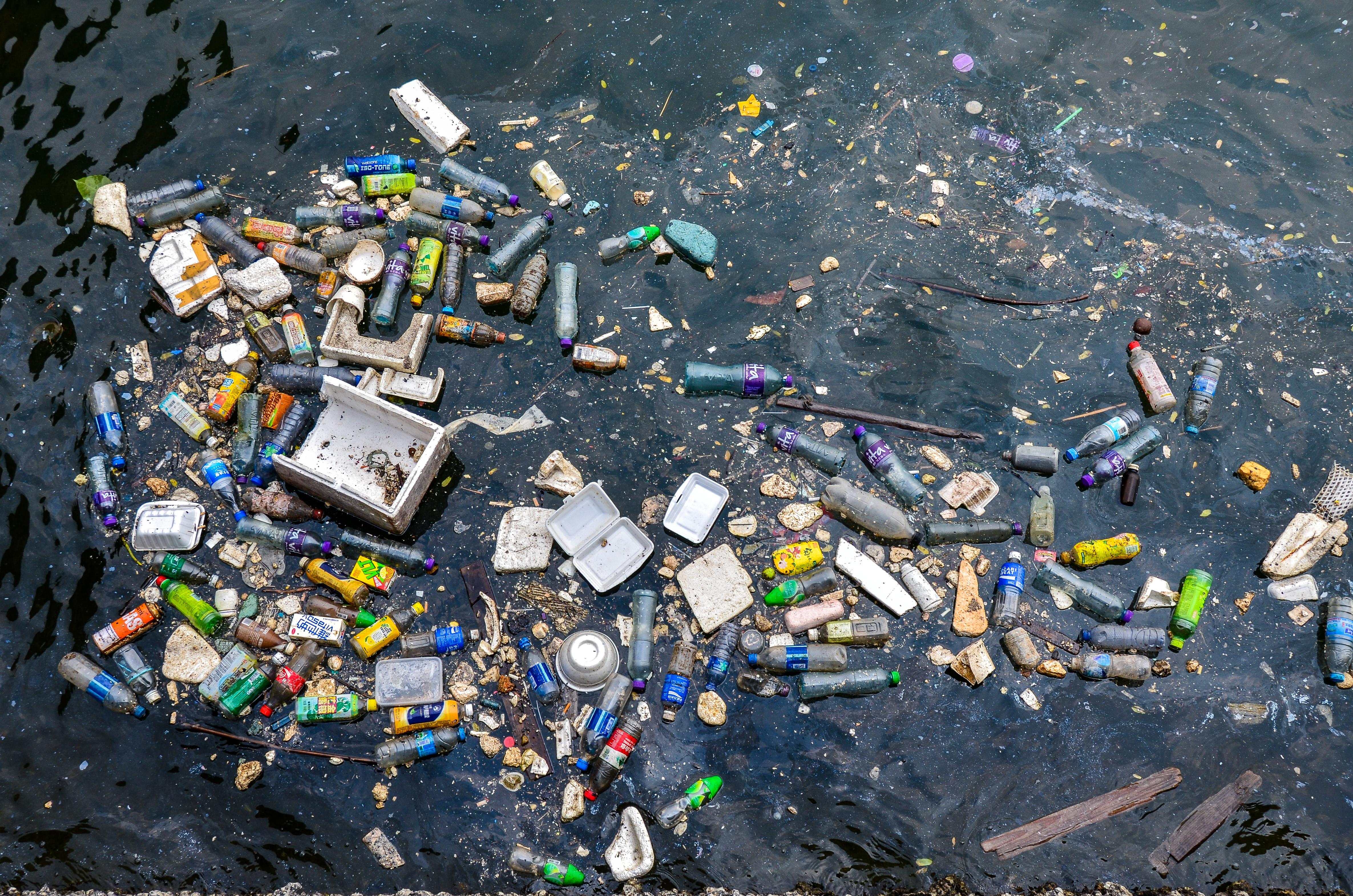 Floating plastic and styrofoam trash polluting a corner of...
