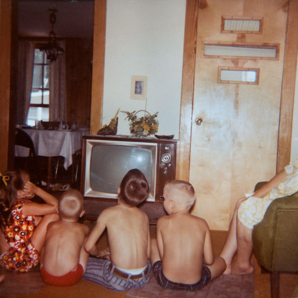 Neighborhood kids watch television, ca. 1969.