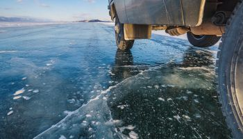 SUV in winter on Lake Baikal