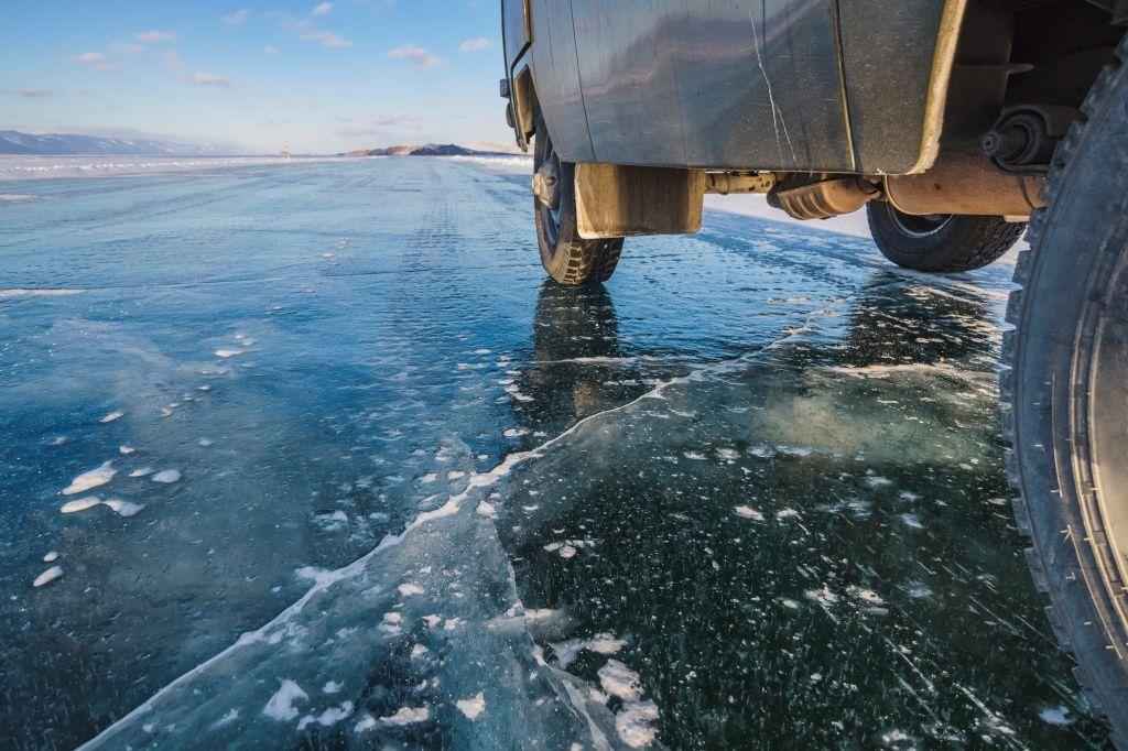 SUV in winter on Lake Baikal