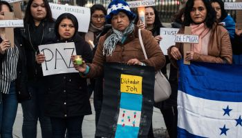 The Honduran community in Madrid marching against President...
