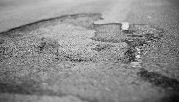 Pothole, black and white - selective focus
