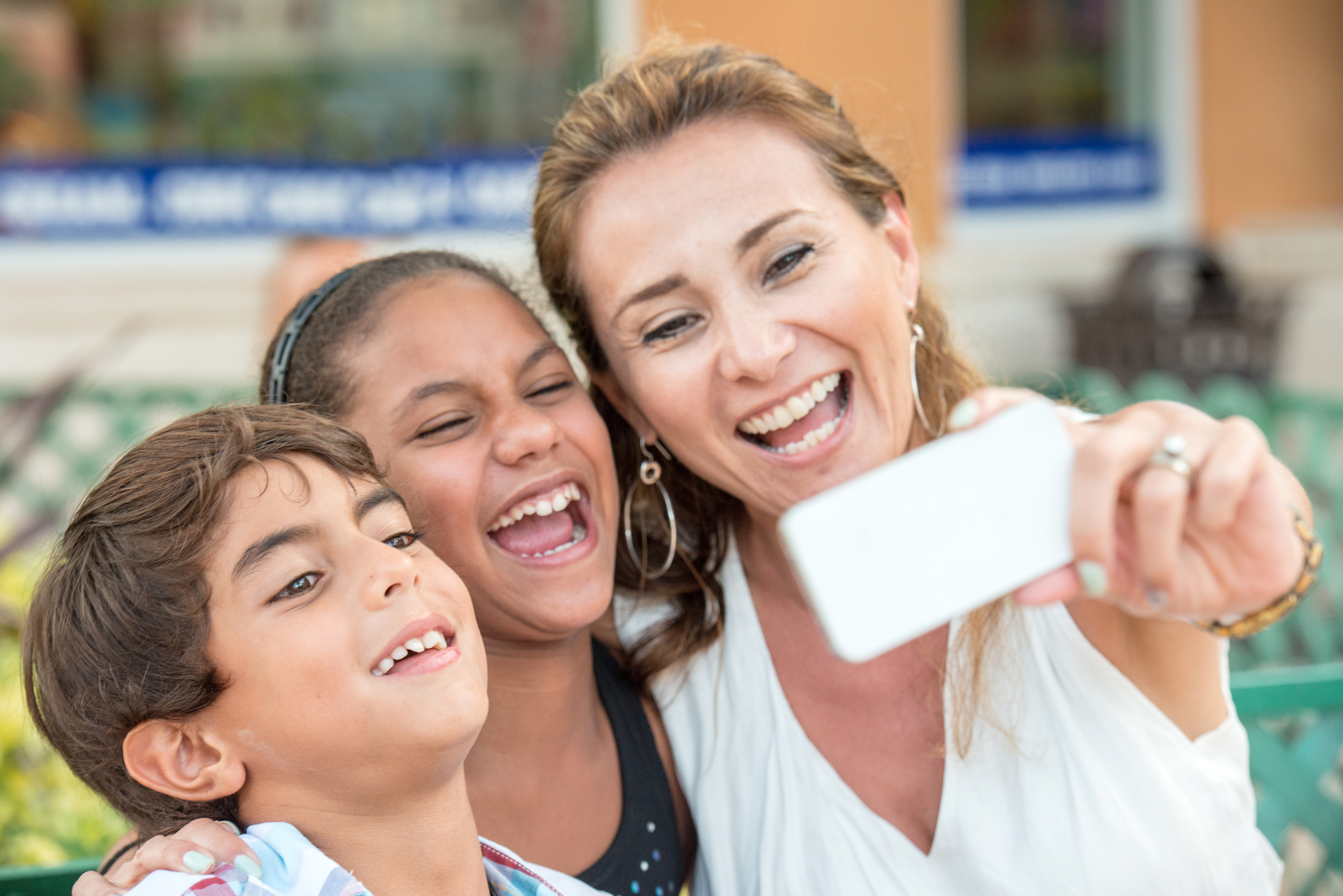 Mature woman posing with her children taking a selfie