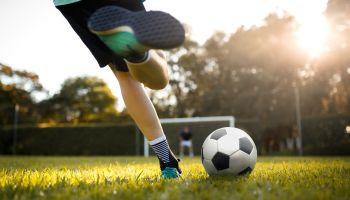Teenager girl playing soccer