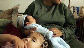 (Phoenix,AZ)–Virgilia Garcia gave birth to her daughter Nareda,1, (foreground) and her son Brando (i