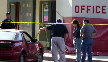 Investigators go over the scene of a fatal accident at Centralia Elementary school where two girls d