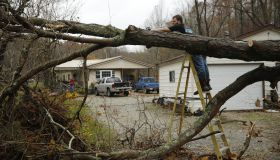 Clearing tornado damage in a driveway