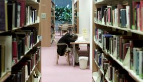 A man sleeps at a table in the Mitchell Library, 18 July 2000. SMH Picture by A