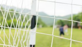 Kids playing soccer on field
