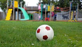Soccer Ball Resting on a Green Grass at the Playground
