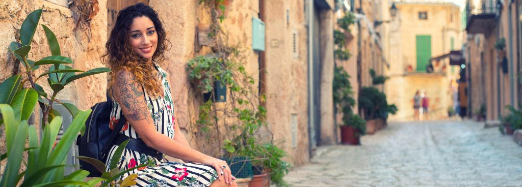 Woman sitting on the street of the old town