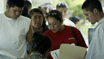 Immigrants wait in line to apply for a matricula card. The matricula is a Mexican identification ca